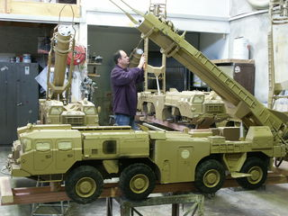 In the workshop Brent Davenport is putting the final touches on one of the scud missile launchers.